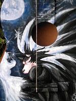 sur Guitare en bois Devant : Mangas Vampire Hunter:Homme loup et vernis